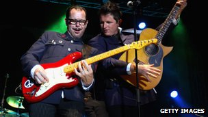 Kirk Pengilly and the new lead singer for INXS Ciaran Gribbin perform on stage at the Perth 2011 Worlds Village on Esplanade Park in 2011.