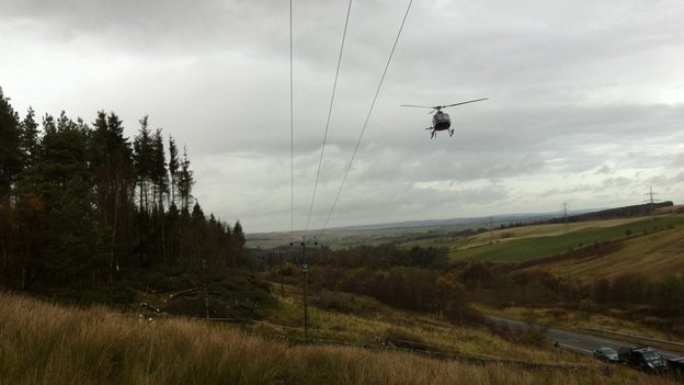 Helicopter surveying the power line at Happendon
