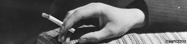A hand holding a cigarette, 1937