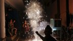 An Indian family lights firecrackers during the festival of Diwali in New Delhi, India, Tuesday, Nov. 13, 2012.
