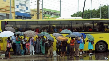 Commuters at Jamaican bus stop, 23 Oct 2012