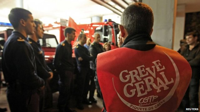 Firefighters in a picket line at their Lisbon headquarters in Portugal, 13 November 2012. The vest reads 'General strike'