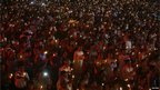 People hold candles during a mass gathering to celebrate Diwali, the Hindu festival of lights, in the western Indian city of Ahmedabad November 13, 2012.