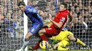 Fernando Torres of Chelsea in action against Liverpool's Steven Gerrard