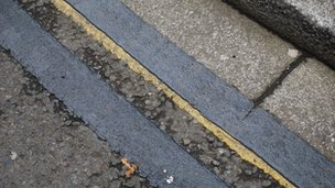 Double yellow lines painted black