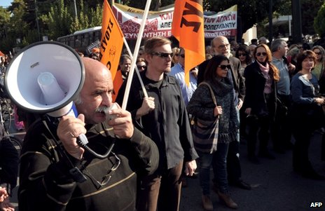 People demonstrate against job cuts in Athens, 13 November