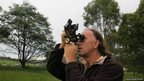 Man taking a photograph. Photo: Martin Walker Watson