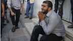 A Palestinian weeps outside the Shifa hospital.