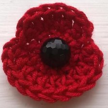 Handmade crocheted Remembrance poppy brooch