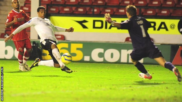 Vadaine Oliver scores for Lincoln against Walsall