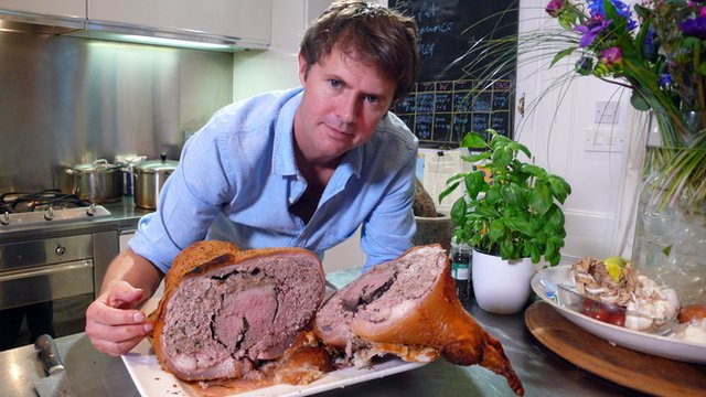 Stefan Gates with a cooked calf's head