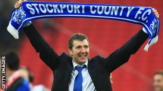 Jim Gannon celebrates Stockport County's promotion to League One in 2008