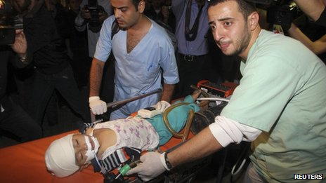 Child injured in air strike, Gaza City, 14 Nov 12