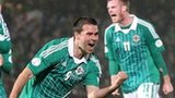 David Healy celebrates after scoring the equaliser