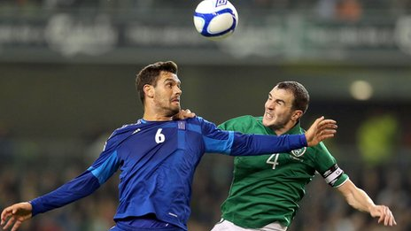 John O'Shea battles with Alexandros Tziolis at the Aviva Stadium