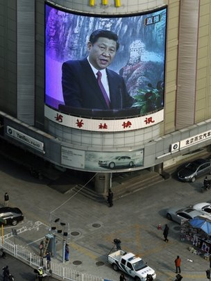 A mall screen shows Chinese Communist Party new General Secretary Xi Jinping speak at a press conference in Beijing Thursday Nov. 15