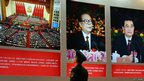 A paramilitary policeman passes portraits of China's President Hu Jintao and former President Jiang Zemin at an exhibition in Beijing ahead of the 18th National Congress of the Communist Party of China, on 30 October 2012