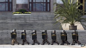 "Chinese soldiers march outside the Great Hall of the People where China""s new leaders meet the press in Beijing Thursday, Nov. 15, 2012."