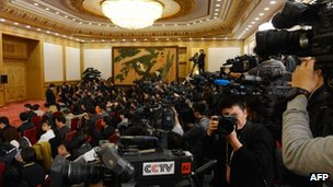 Journalists wait for the arrival of Xi Jinping after he was appointed as the head of the newly reshuffled seven member Communist Party of China Politburo Standing Committee