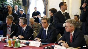 German Defence Minister Thomas de Maiziere, second left, and German Foreign Minister Guido Westerwelle, centre, attend the Paris talks, 15 November