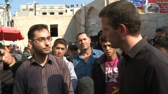 Jon Donnison talking to Gaza resident
