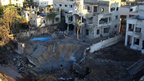 A crater at an area targeted by an Israeli air strike in Gaza City.