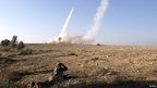An Israeli soldier watches as an Iron Dome launcher fires an interceptor rocket near the southern city of Beersheba.