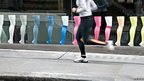 Runner passes a shop window