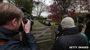 Reporters wait outside a house belonging to former Radio One disc jockey Dave Lee Travis 