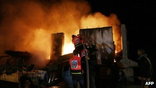 Firemen tackle a blaze in Gaza City