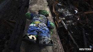 A burned stuffed toy is seen in a home devastated by fires during Sandy in the Belle Harbor section of the Queens borough of New York on 15 November 2012