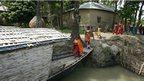 Children board a floating school