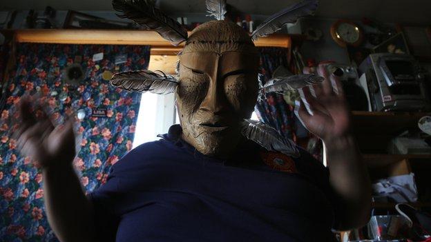Steve Oomituk wearing a traditional mask
