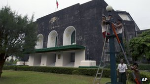 Workers repairing light fixtures outside Rangoon University's Convocation Hall, 15 November 2012