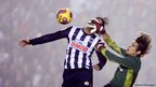 Monterrey's Aldo de Nigris (left) jumps for the ball with Tijuana's goalkeeper Cirilo Saucedo