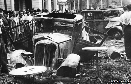 Burnt-out cars in Barcelona after the defeat of a pro-Franco uprising in the city at the start of the Spanish Civil War in 1936