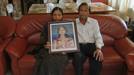 Savita Halappanavar's parents hold their daughter's picture