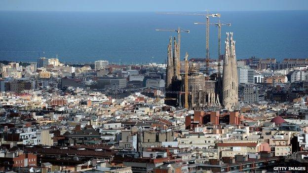 View across Barcelona towards Antoni Gaudi's unfinished La Sagrada Familia cathedral