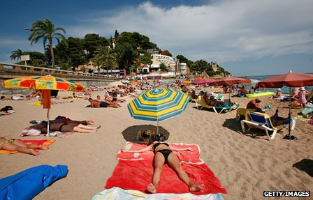 Holidaymakers on the beach in Lloret de Mar
