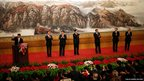 Xi Jinping leads the new politburo standing committee on to the stage at the Great Hall of the People in Beijing