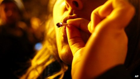 A woman smokes marijuana in Seattle on Tuesday 6 November