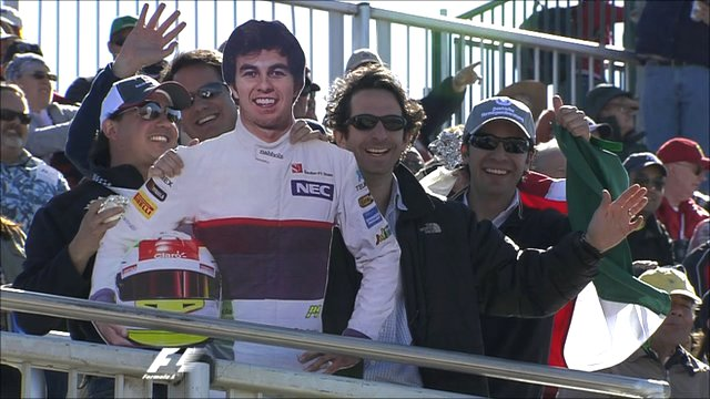 Fans pose with a cardboard cut-out of Sergio Perez