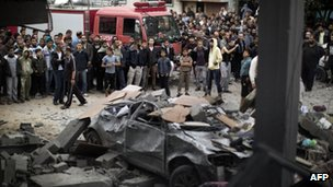 Palestinians gather at the site of an Israeli air raid in Gaza City on November 17, 2012
