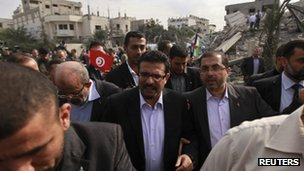 Tunisia&#039;s Foreign Minister Rafik Abdessalem (centre) visits the destroyed office of Hamas Prime Minister Ismail Haniyeh in Gaza City.