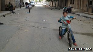 Child riding bike in Gaza