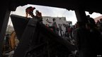 Palestinians search through the wreckage of buildings in Jabaliya, northern Gaza (17 Nov)