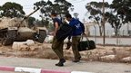 Israeli reservist soldiers arrive at a base in southern Israel (17 Nov)