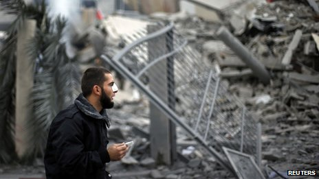 Hamas policeman outside the destroyed office building of Hamas Prime Minister Ismail Haniyeh, 17 November 2012