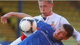 Linfield's Matthew Tipton is challanged by Kris Lindsay