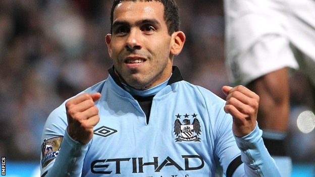 Carlos Tevez celebrates after scoring Manchester City&#039;s third goal